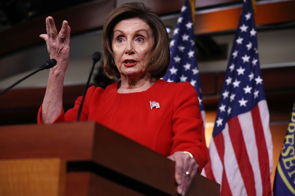 Speaker of the House Nancy Pelosi (D-CA) holds her weekly news conference in the House Visitors Center at the US Capitol thursday in Washington, DC. Pelosi faced questions from reporters as public hearings in the impeachment inquiry of President Donald Trump began this week. — AFP