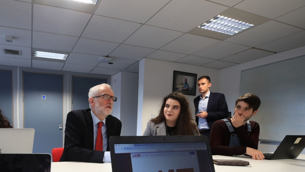 Britain's opposition Labour party leader Jeremy Corbyn talks with students at Lancaster University regarding the party's plans to deliver fast and free full fiber broadband across the country if they win the General Election on Friday. — AFP