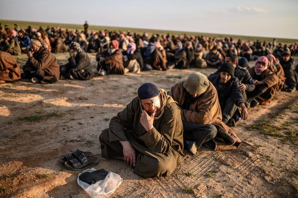 Suspected Daesh (the so-called IS) fighters wait to be searched after leaving the militants' last holdout in eastern Syria in this file photo. — AFP