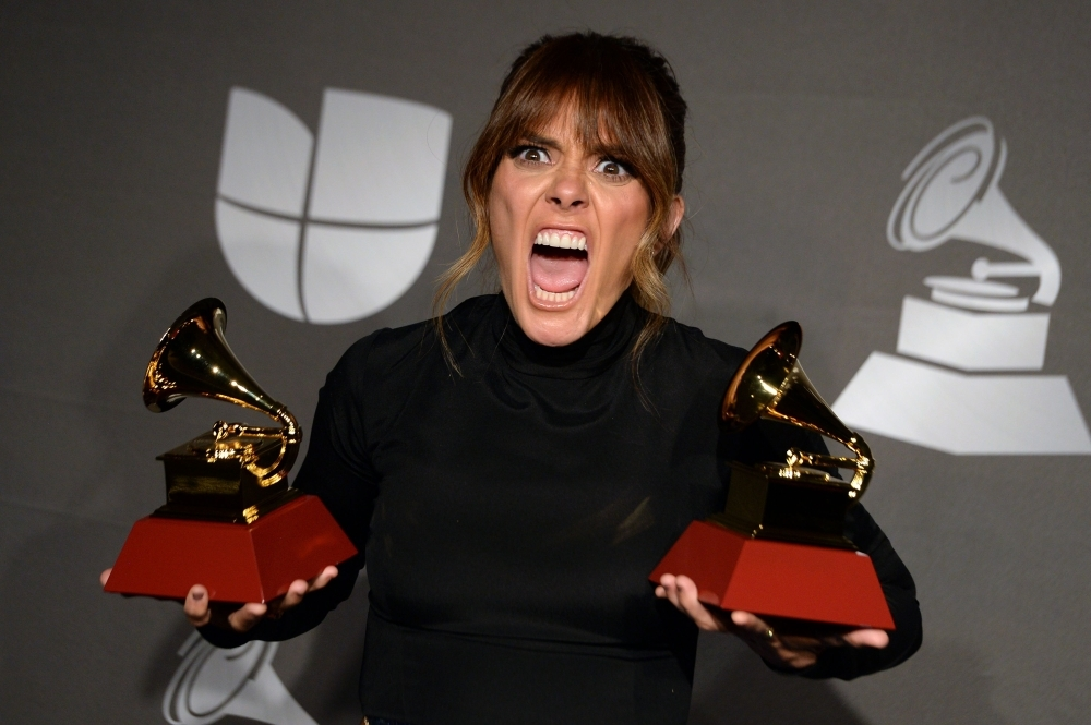 Puerto Rican singer Kany Garcia poses in the press room with the awards for