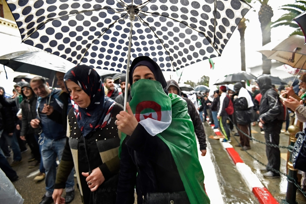 Algerian protesters rally to reiterate their opposition to a presidential election in Algiers on Friday. — AFP