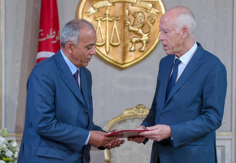 Tunisia's new Prime Minister Habib Jemli, left, takes his oath from President Kais Saied at the presidential palace in the capital's eastern suburb of Carthage on Friday. — AFP