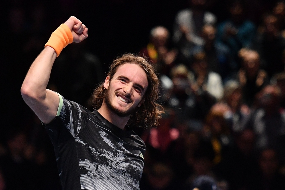 Greece's Stefanos Tsitsipas celebrates victory against Switzerland's Roger Federer during the men's singles semi-final match on day seven of the ATP World Tour Finals tennis tournament at the O2 Arena in London on Saturday. — AFP