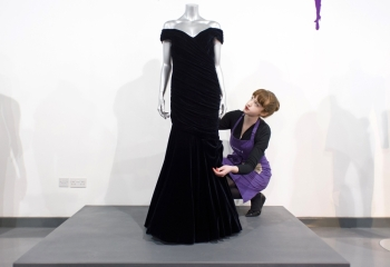 A Victor Edelstein midnight blue velvet evening gown, worn by Britain's Princess Diana at the State Dinner at the White House in 1985, when she danced with US actor John Travolta, is pictured at the Kerry Taylor Auction house in south London ahead of its sale. — AFP