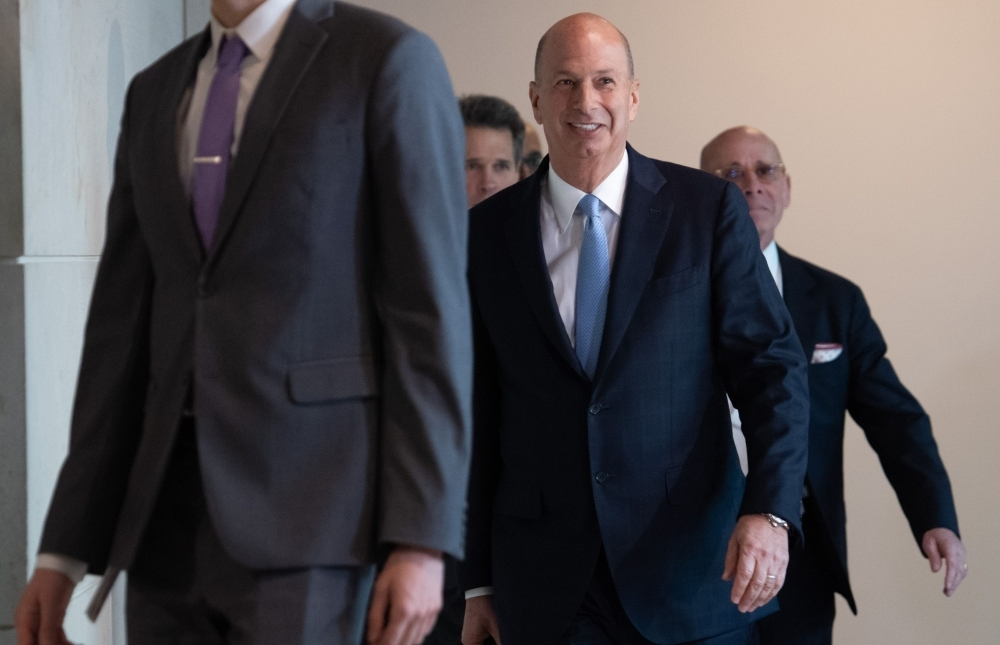 In this file photo US Ambassador Gordon Sondland (C) arrives at the US Capitol on October 17, 2019, in Washington, DC.  -AFP