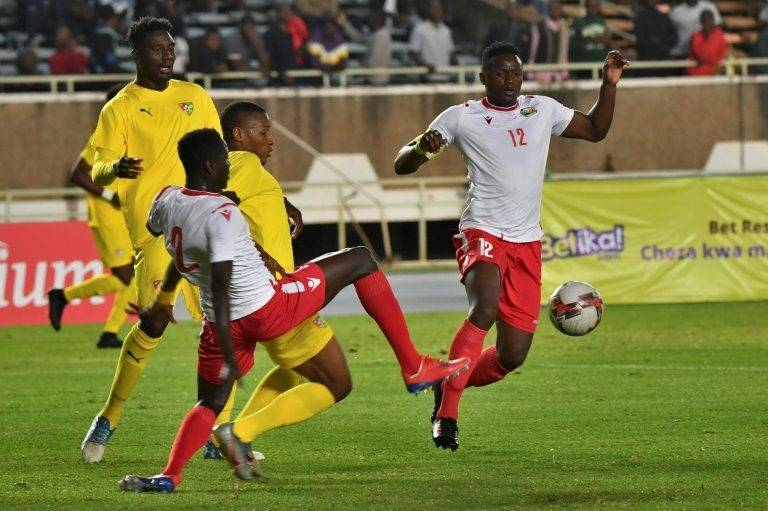 Peniel Mlapa (L) and Kodjo Fo-Doh Laba of Togo and Victor Wanyama (R) and Stanley Okumu of Kenya seek possession during a drawn Cup of Nations qualifier. — AFP