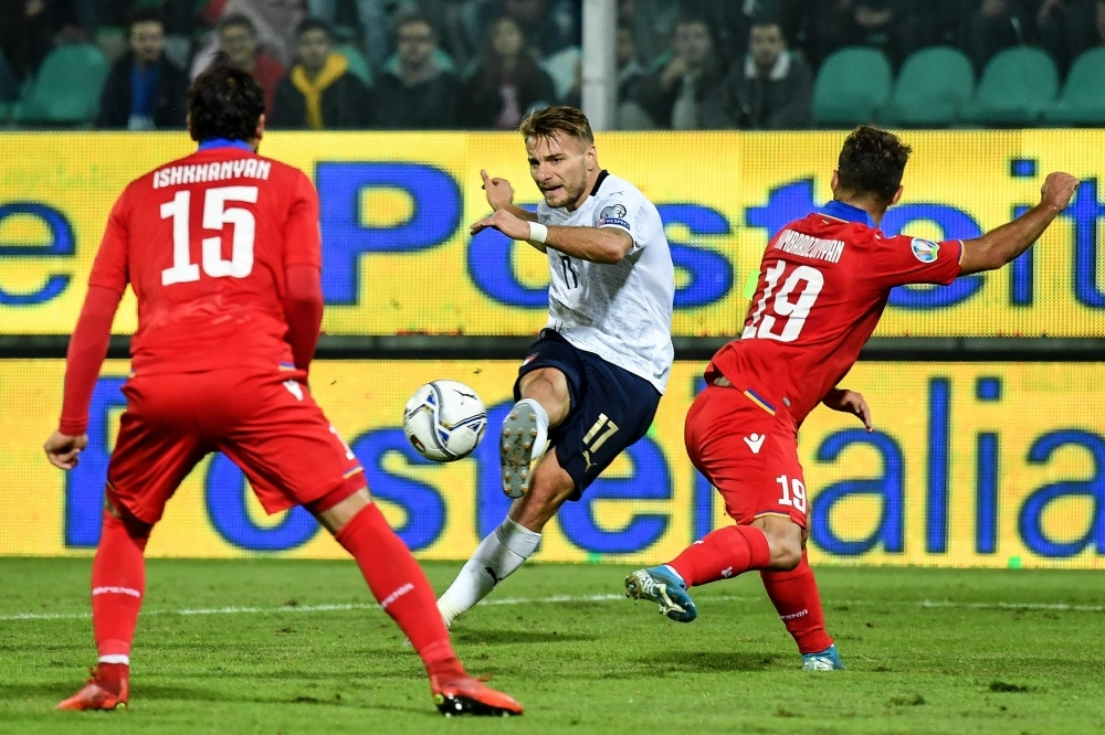 Italy's forward Ciro Immobile (C) shoots on goal during the Euro 2020 1st round Group J qualifying football match Italy v Armenia at the Renzo-Barbera stadium in Palermo on Monday. — AFP