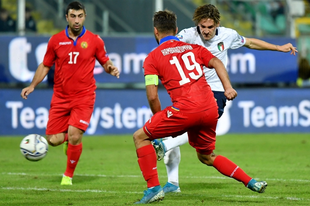Italy's midfielder Nicolo Zaniolo (R) shoots to score his second goal during the Euro 2020 1st round Group J qualifying football match Italy v Armenia on November 18, 2019 at the Renzo-Barbera stadium in Palermo on Monday. — AFP