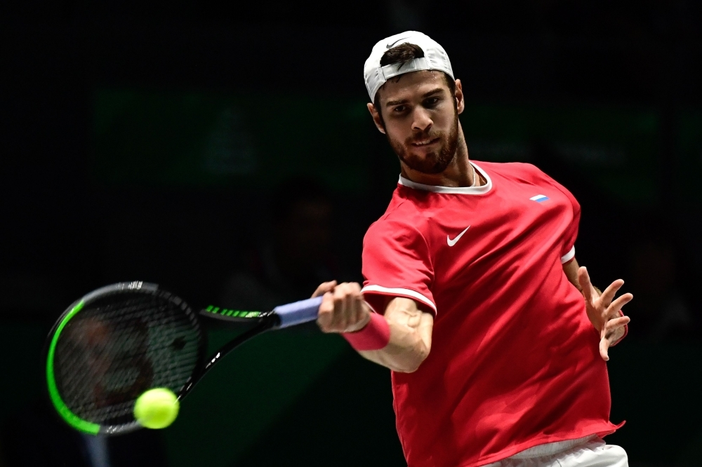Russia's Karen Khachanov returns the ball to Croatia's Borna Coric during the singles tennis match between Croatia and Russia at the Davis Cup Madrid Finals 2019 in Madrid on Monday. — AFP