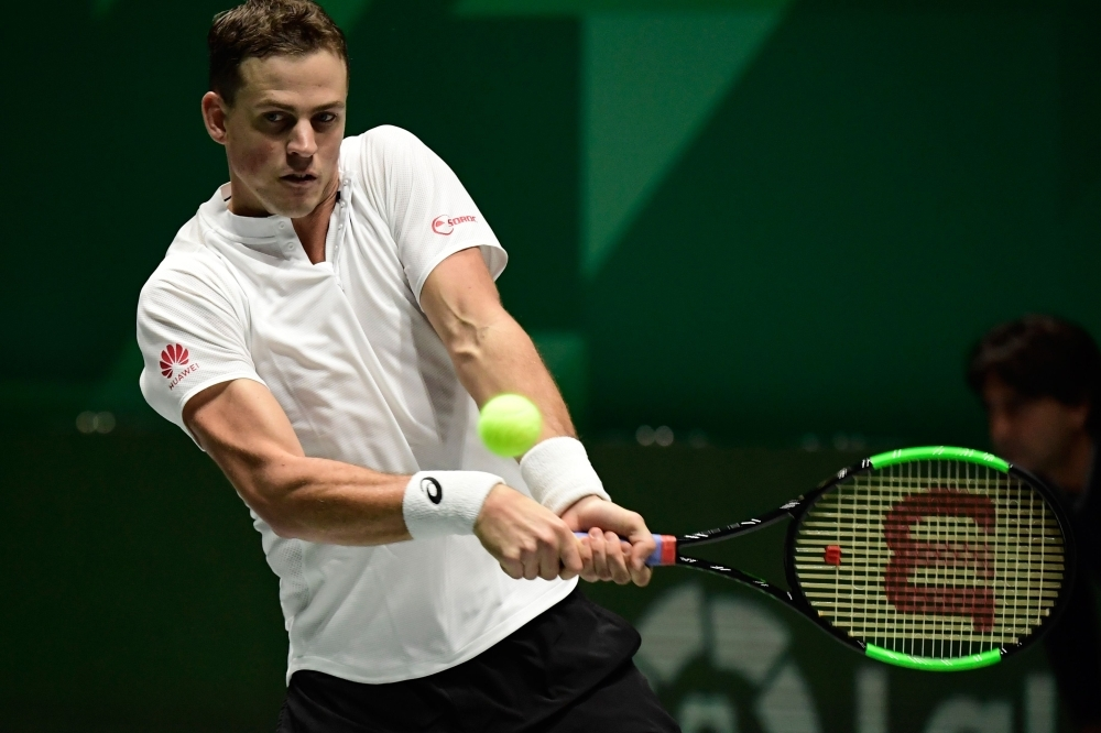 Canada's Vasek Pospisil returns the ball to Italy's Fabio Fognini during the singles tennis match between Italy and Canada at the Davis Cup Madrid Finals 2019 in Madrid on Monday. — AFP