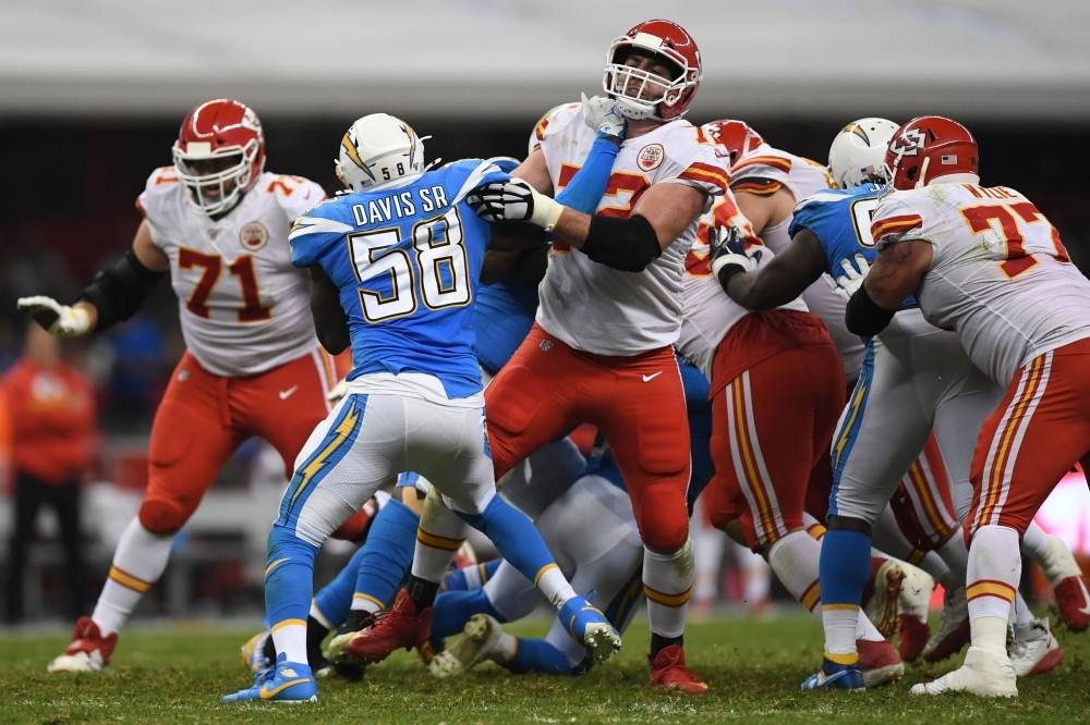 Charger defender Thomas Davis crashes with Chiefs players during the 2019 NFL week 11 regular season football game between Kansas City Chiefs and Los Angeles Chargers at the Azteca Stadium in Mexico City on Monday. — AFP