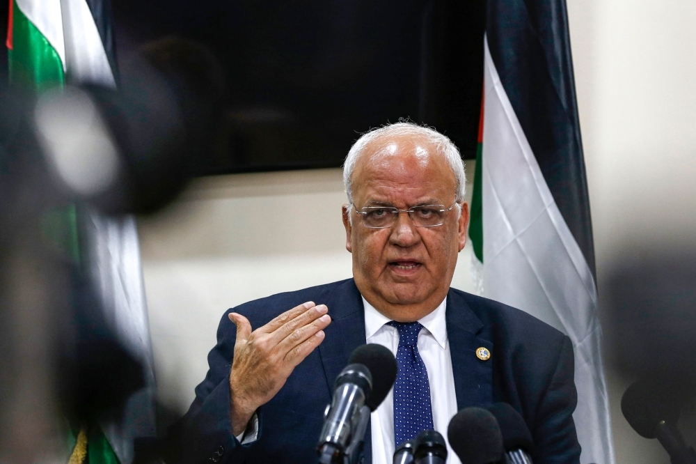 Saeb Erekat, Secretary General of the Palestine Liberation Organization (PLO) and chief Palestinian negotiator, speaks during a press conference in the Palestinian West Bank city of Ramallah on Tuesday. — AFP