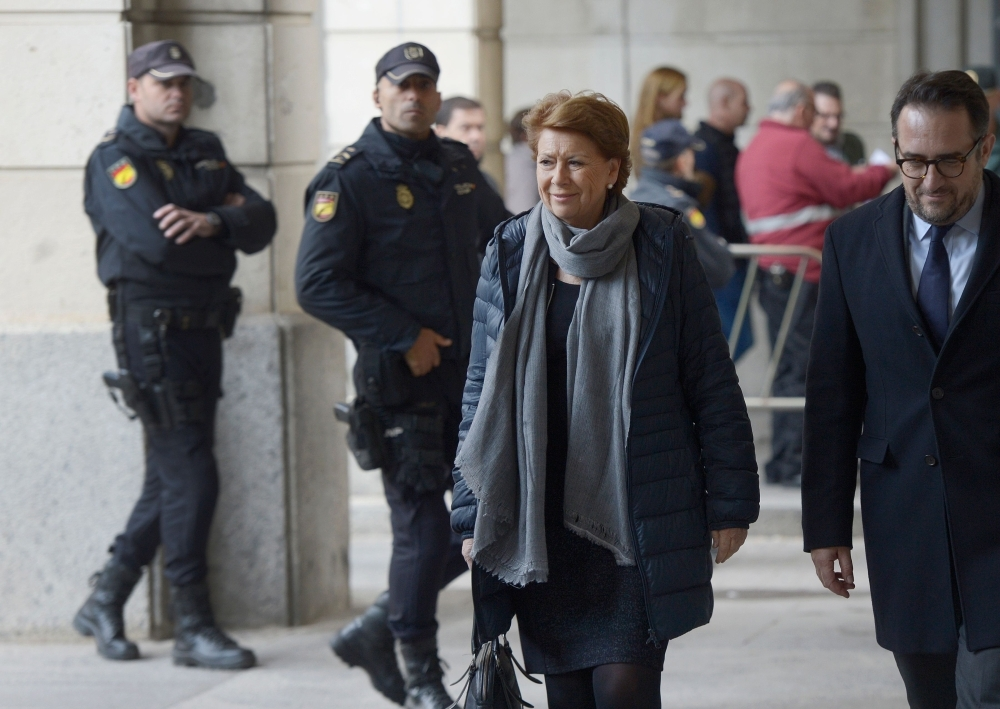Former General Controller of the board of Andalusia Manuel Gomez Martinez, center,  arrives at the courthouse in Seville, Spain, on Tuesday. — AFP