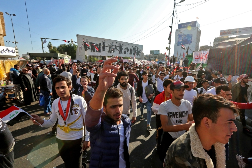 Iraqi anti-government protesters are pictured at Tahrir square on Tuesday. — AFP