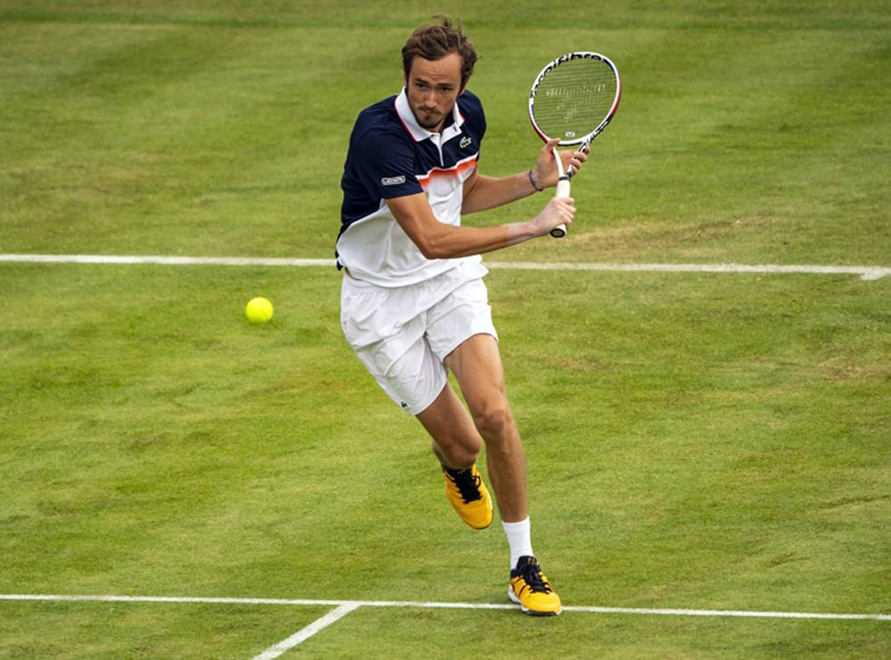 In this file photo taken on June 20, 2019, Daniil Medvedev of Russia hits a backhand against Lucas Pouille of France during day 4 of the Fever-Tree Championships at Queens Club in London, United Kingdom. — Courtesy photo