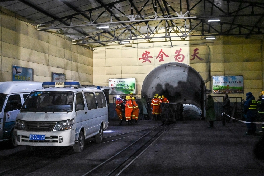 Rescuers work at the site of a coal mine explosion in Pingyao, in China's northern Shanxi province, early on Tuesday. — AFP