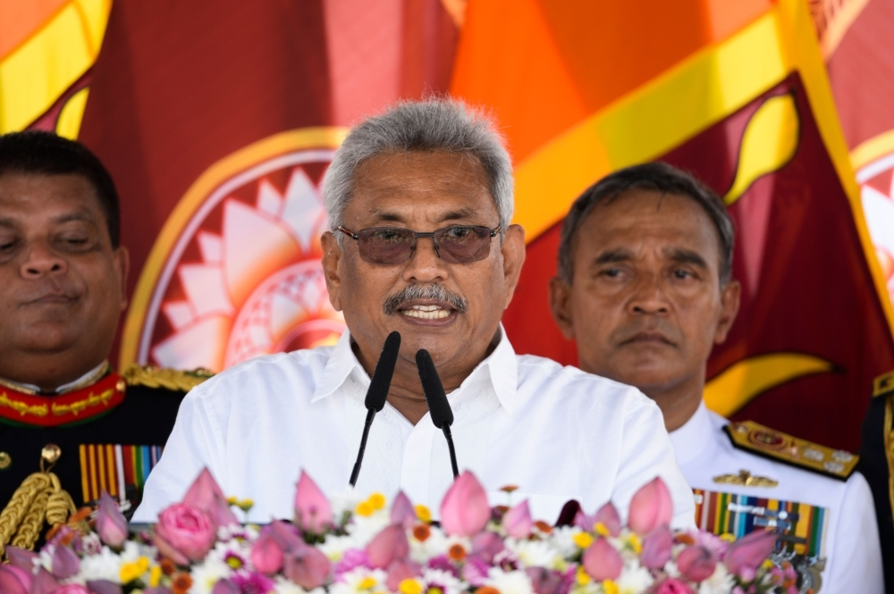 Sri Lanka's new President Gotabaya Rajapaksa, center, speaks after taking oath of office during his swearing-in ceremony at the Ruwanwelisaya temple in Anuradhapura on Monday. — AFP