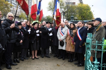 Paris' mayor Anne Hidalgo (first row, 4thR) and mayor of Paris' 13th district Jerome Coumet (first row, 3rdR) spend a moment in silence, on Monday at Place d'Italie in Paris in front of the  the damaged monument to World War II hero Marshal Alphonse Juin which was defaced by demonstrators dressed in black two day ago during the