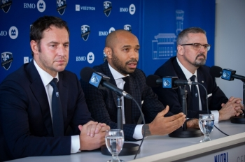 (L-R) Olivier Renard, Sporting Director,Thierry Henry, and Kevin Gilmore, President & Chief Executive Officer speak as The Montreal Impact invites members of the media to meet Thierry Henry, the new head coach at a press conference at the Center Nutrilait, in Montreal, Quebec, Canada, on Monday. — AFP