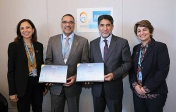 Dr. Hani Jokhdar, deputy minister for public health, receivs the