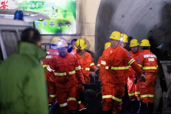 Rescuers carry a victim at the site of a coal mine explosion in Pingyao, in China's northern Shanxi province, early on Tuesday. — AFP