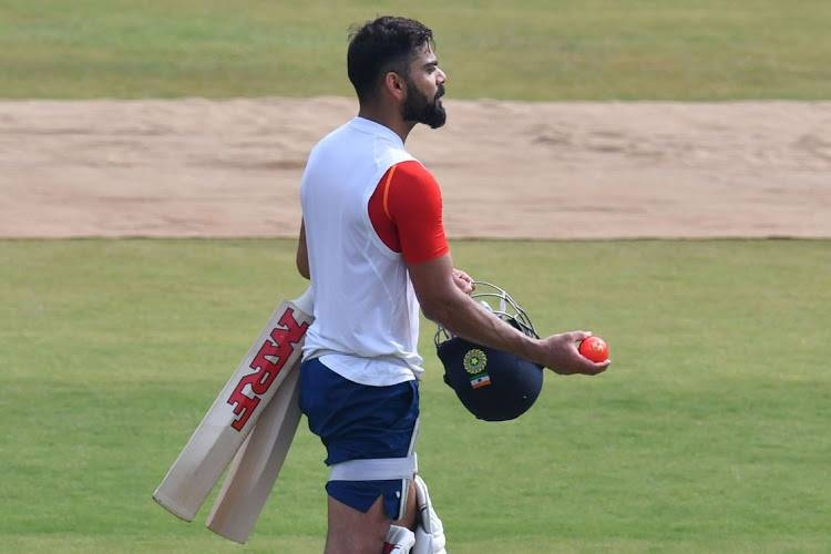 In this picture taken on Nov. 13, 2019, India's cricket team captain Virat Kohli throws a pink cricket ball during a training session at Holkar Cricket Stadium in Indore. — AFP
