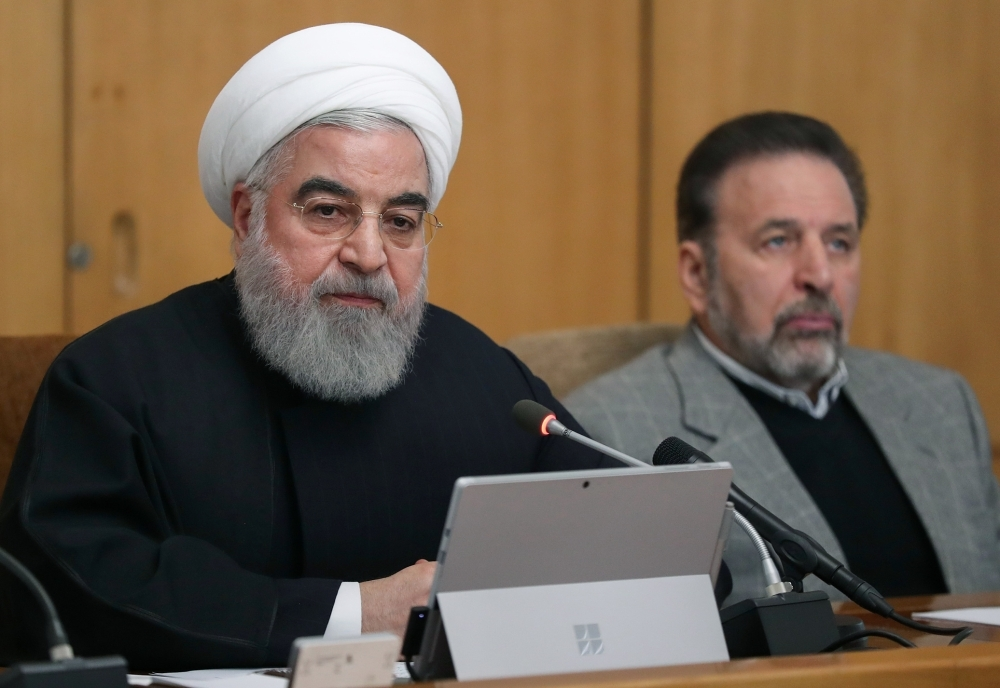 Iranian President Hassan Rohani, left, chairs a Cabinet meeting in Tehran on Wednesday. — AFP