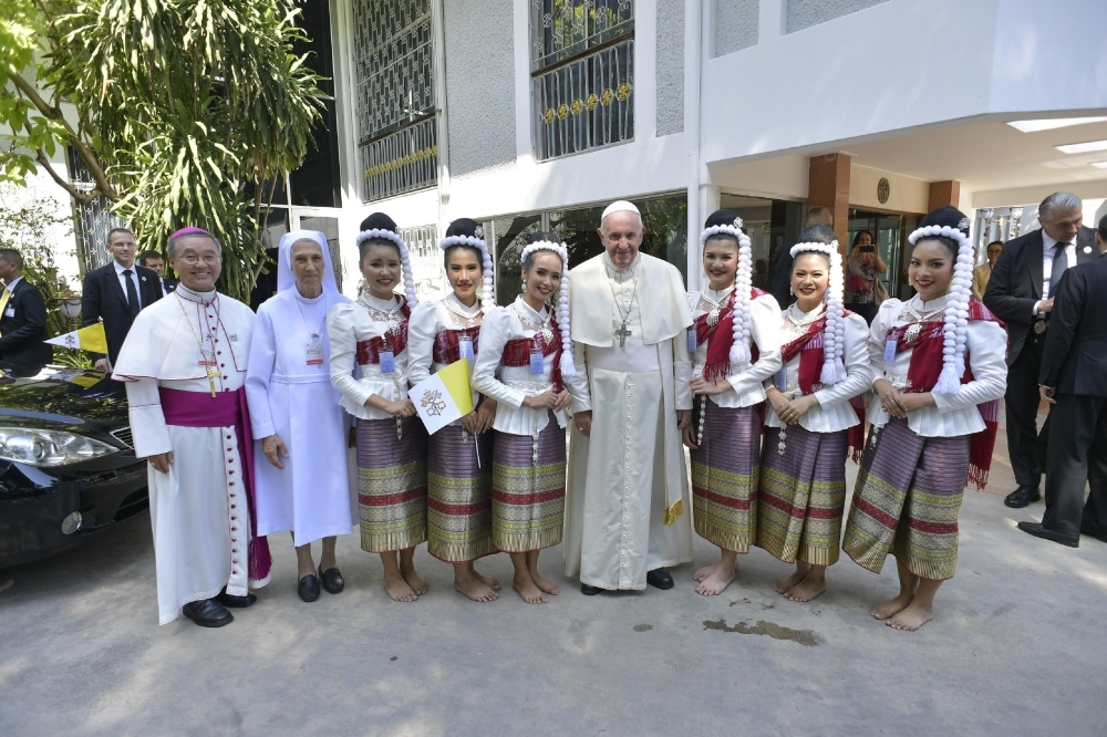 Pope Francis, center, is seen during his arrival to the Apostolic Nunciature of the Holy See in Bangkok, Thailand, on Wednesday. — AFP