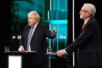 Britain's Prime Minister Boris Johnson (L) and Britain's Labour Party leader Jeremy Corbyn (R) debate on the set of