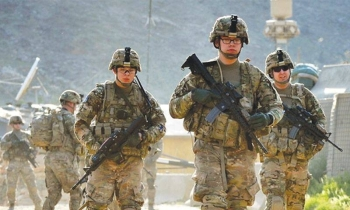 US soldiers march from a forward base in the eastern province of Kunar, Afghanistan, in this file photo. — AFP