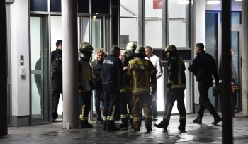 Policemen, firefighters and medical staff stand in front of the hospital after a doctor was stabbed to death as he delivered a lecture at the Schlosspark hospital in the western Berlin neighborhood of Charlottenburg, on Tuesday. — AFP