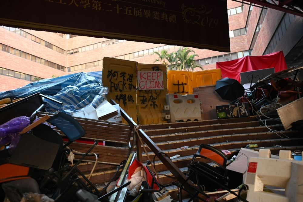 A barricade is seen at the campus of the Hong Kong Polytechnic University where dozens of pro-democracy protesters remain holed up inside, in the Hung Hom district of Hong Kong, on Thursday. — AFP