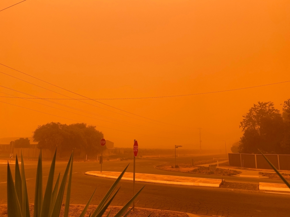 The sky turns orange from dust storms caused by bushfires in Mildura in Victoria state on Thursday. — AFP