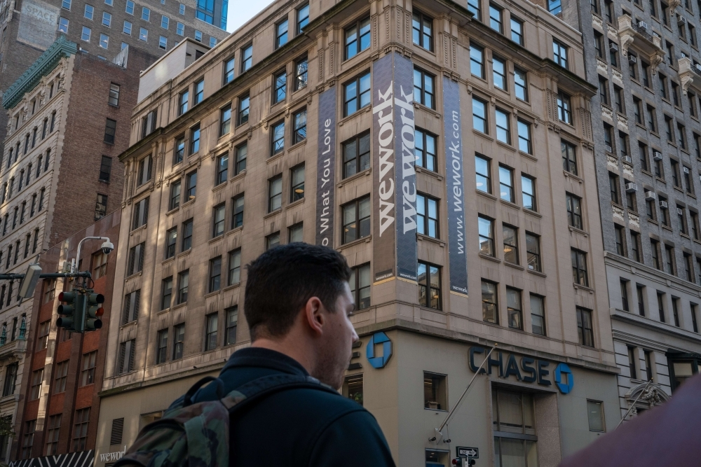 WeWork offices located at 349 5th Ave on Thursday in New York City. WeWork has laid off 2,400 employees as it works to cut costs in its attempts to right-size the business.— AFP