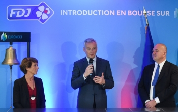 French Economy Minister Bruno Le Maire (C) speaks next to Francaise des Jeux head Stephane Pallez (L) and Euronext Group's Chairman and CEO Stephane Boujnah after the launch of the initial public offering of France's lottery Francaise des Jeux (FDJ) at the Paris Stock Exchange Euronext (Bourse) in Paris on Thursday. — AFP