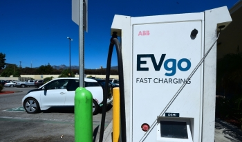 In this file photo taken on Sept. 14, 2018 An Electric Vehicle is plugged in for a charge from EV charging stations at a Walmart parking lot in Duarte, California. The rise of electric cars is proving a challenge not only for auto makers but also gas stations, supermarkets and malls forced to adapt as more and more electric vehicles hit the road, experts say. — AFP