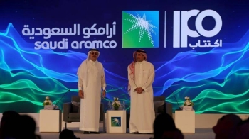 Aramco Chairman Yasir Al-Rumayyan, right, and Aramco CEO Amin Nasser at the launch of the Aramco IPO on Nov. 17.