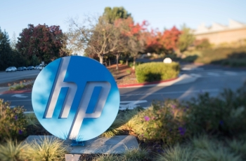 In this file photo taken on Nov. 4, 2016 the HP logo is seen on a sign at Hewlett Packard's headquarters in Palo Alto, California. — AFP