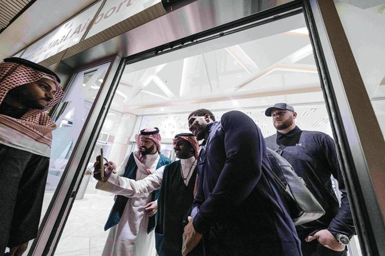 Saudi fans taking selfies with Anthony Joshua as he lands at the King Khalid International Airport in Riyadh. — Courtesy photo