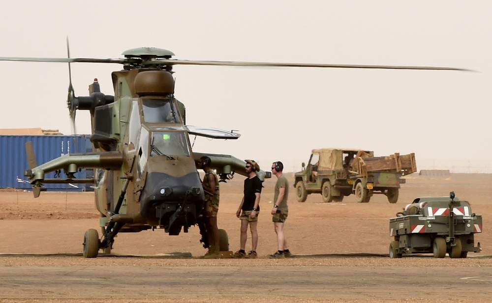 Thirteen French soldiers killed in Mali helicopter collision during fight with insurgents