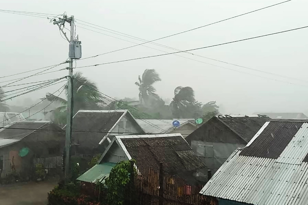 Heavy rains and moderate wind batter houses in Gamay town, Northern Samar province, central Philippines on Monday as Typhoon Kammuri hits the province. -AFP