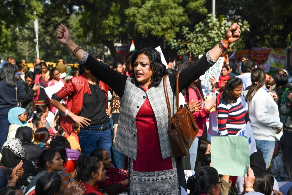 Social activists and supporters shout slogans to protest against the alleged rape and murder of a 27-year-old veterinary doctor in Hyderabad, during a demonstration in New Delhi, on Tuesday. — AFP