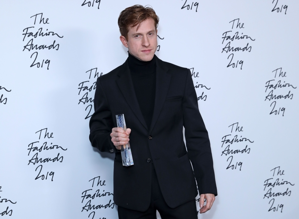 Bottega Veneta Creative director Daniel Lee poses after the company won the Brand of the Year award, following their award presentation at The Fashion Awards 2019 in London, on Monday. — AFP
