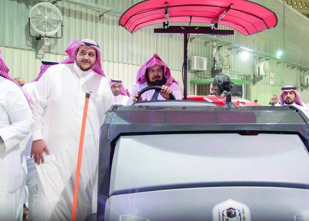President of the General Presidency of the Affairs of the Two Holy Mosques Sheikh Abdul Rahman Al-Sudais tests the effectiveness of the new cleaning vehicle. — Courtesy photo
