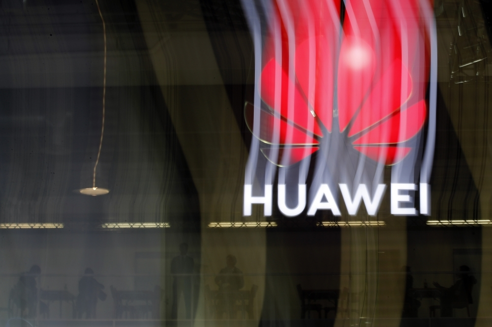 An illuminated Huawei sign is on display during the 10th Global mobile broadband forum hosted by Huawei in Zurich, Switzerland, in this Oct. 15, 2019 file photo. — AFP