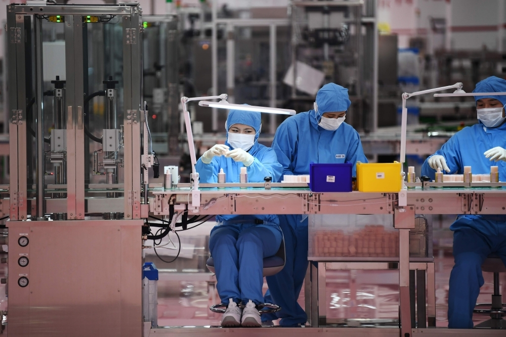 Workers are seen at the inauguration of a new production plant for Japanese cosmetics brand Shiseido in Otawara, Tochigi prefecture, Japan, in this Nov. 27, 2019 file photo. — AFP