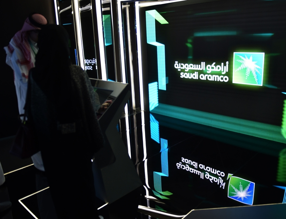 n this file photo taken on Nov. 13, 2019, visitors stop at the Aramco exhibition section at the Misk Global Forum on innovation and technology held in Riyadh. — AFP