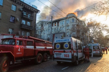 Firefighters extinguish a fire inside a college building in central Odessa, Ukraine, on Wednesday. — AFP