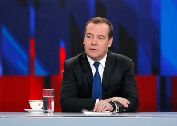 Russian Prime Minister Dmitry Medvedev gives a live interview on the annual results of the government work to journalists of Russia's television channels in Moscow on Thursday. — AFP