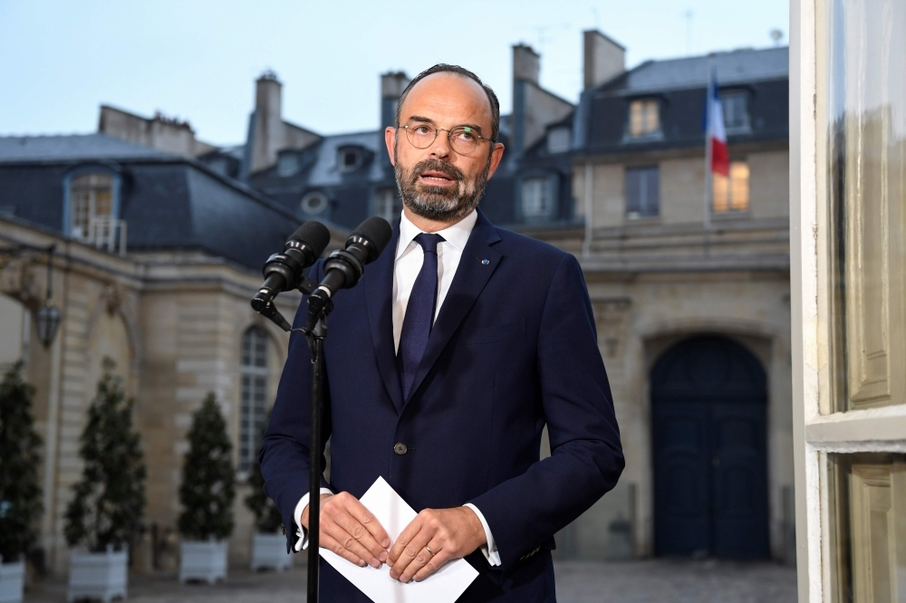 French Prime Minister Edouard Philippe gives a press conference during a general strike over French government's plan to overhaul the country's retirement system, at the Matignon palace in Paris, on Friday. — AFP